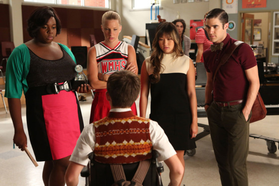 "GLEE: L-R: Unique (guest star Alex Newell), Brittany (Heather Morris), Tina (Jenna Ushkowitz) and Blaine (Darren Criss) ask Artie (Kevin McHale, bottom) to pick one of them as the next glee club star in ""The New Rachel,"" the Season Four premiere epis"