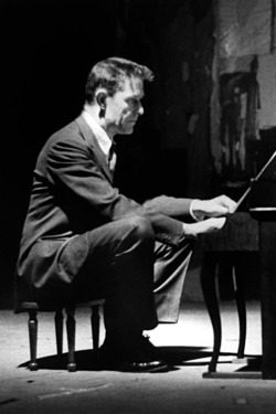 Avant-garde minimalist composer John Cage playing a children's size piano.  (Photo by Ben Martin//Time Life Pictures/Getty Images)