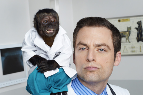 ANIMAL KINGDOM -- Season: Pilot -- Pictured: (l-r) Monkey as Dr. Zaius, Justin Kirk as Dr. George Coleman -- (Photo by: Chris Haston/NBC)