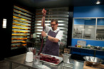 Cosentino, making blood sausages on <em>Top Chef Masters.</em>