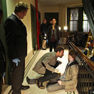 """While you Were Sleeping"" – Sherlock (Jonny Lee Miller, center) uses his powers of deduction to consult on the murder of a young man who is shot upon entering his apartment. Also pictured is Jon Michael Hill (far right) Aidan Quinn (right), Lucy Liu (center)  in ELEMENTARY on October 4 (10:00-11:00 PM, ET/PT) on the CBS Television Network. PHOTO CREDIT:  GIOVANNI RUFINO/CBS © 2012 CBS.  All Rights Reserved."