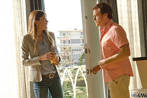 Jennifer Carpenter as Debora Morgan and Michael C. Hall as Dexter Morgan (Seaso