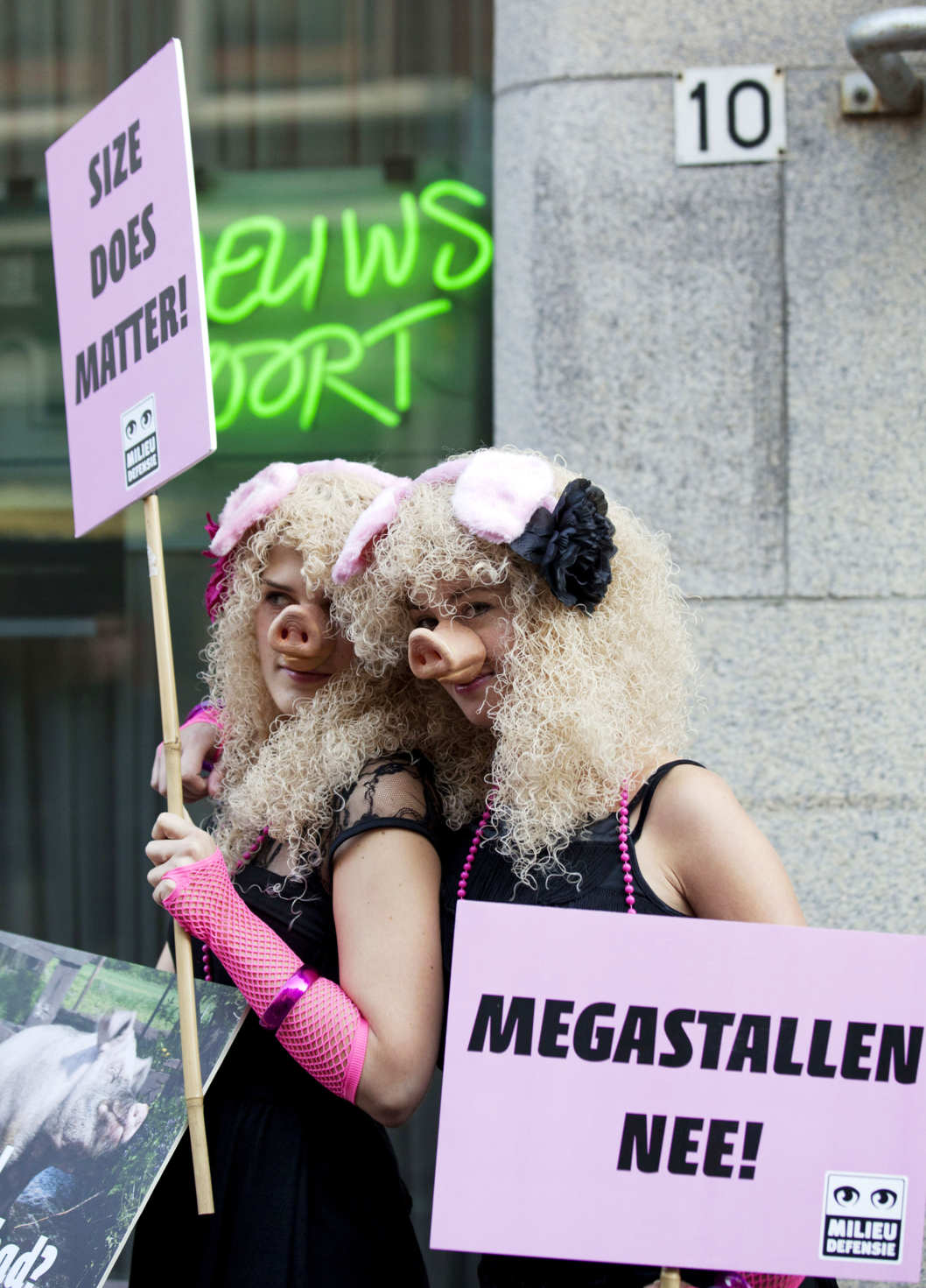 Two members of Dutch environmentalist group Milieudefensie (Environmental Defence) wear Miss Piggy costumes as they join a protest against the further expansion of livestock farming in The Hague on September 23, 2011.  AFP PHOTO/ANP/PHIL NIJHUIS netherlands out - belgium out (Photo credit should read PHIL NIJHUIS/AFP/Getty Images)