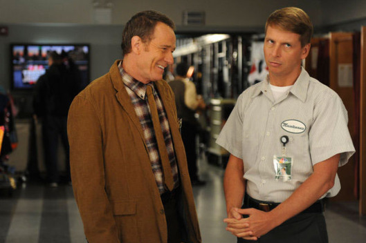 "30 ROCK -- ""Governor Dunston"" Episode 702 -- Pictured: (l-r) Brian Cranston as Ron, Jack McBrayer as Kenneth Parcell."