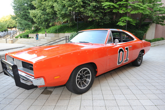 Singer / Actor/ Politician BEN JONES who played COOTER DAVENPORT in the hit television show The Dukes of Hazzard poses with the famed car from the television series The General Lee while at The Carolina Theater located in Durham.