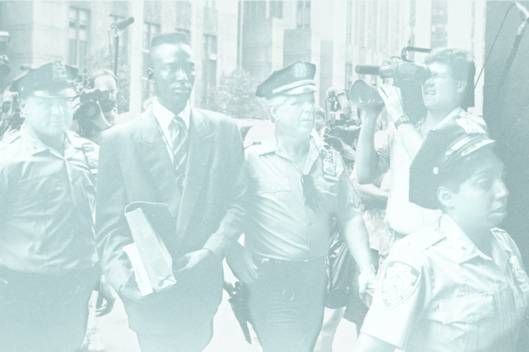 UNITED STATES - AUGUST 18:  Accused rapist Yusef Salaam is escorted by police.  (Photo by Clarence Davis/NY Daily News Archive via Getty Images)