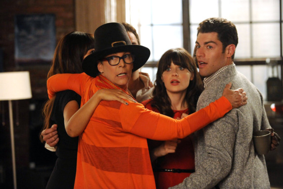 "NEW GIRL:   The gang joins Jess (Zooey Deschanel, C) for a group hug when her mom (guest star Jamie Lee Curtis, L) arrives for a visit in the ""Parents"" e"