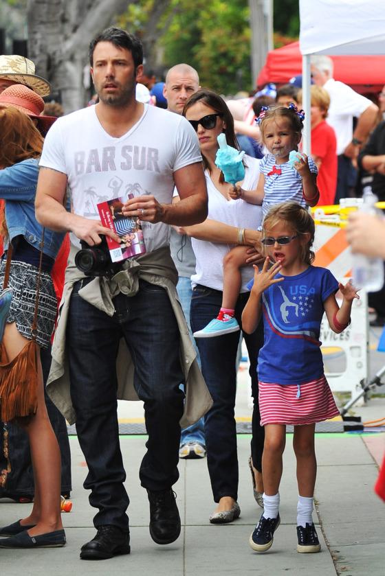 Ben Affleck and Jennifer Garner take their girls to a 4th of July parade.