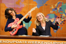 "SATURDAY NIGHT LIVE -- Episode 9 -- Aired 01/15/2005 -- Pictured: (l-r) Tina Fey, Amy Poehler during ""Weekend Update"""