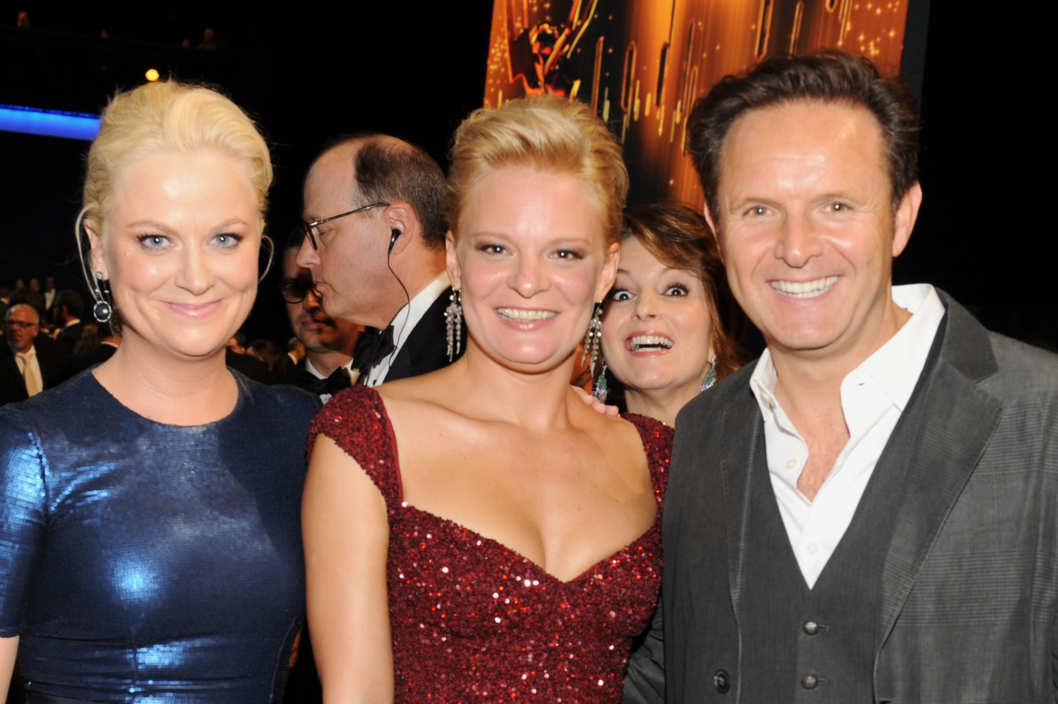 (L-R) Amy Poehler, Martha Plimpton and Mark Burnett backstage during the Academy of Television Arts & Sciences 63rd Primetime Emmy Awards at Nokia Theatre L.A. Live on September 18, 2011 in Los Angeles, California.
