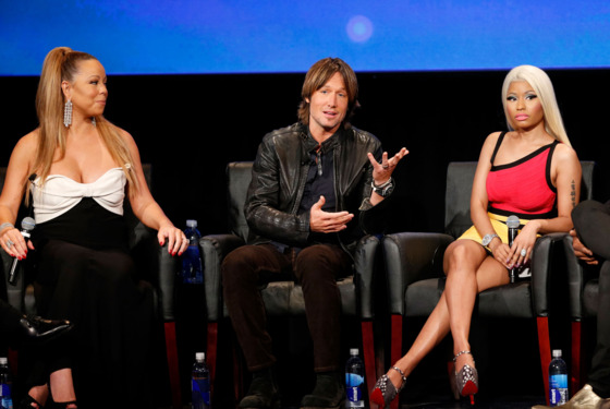 (L-R) Singer Mariah Carey, musician Keith Urban, and singer Nicki Minaj onstage during a live Q&A during the season premiere screening of Fox's 'American Idol' at Royce Hall, UCLA on January 9, 2013 in Westwood, California.