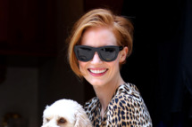 Actress Jessica Chastain, wearing a leopard print summer dress with flats, shows off her dog named Chaplin on the set of 'The Disappearance of Eleanor Rigby: His' in Chelsea in New York City. Jessica changes in a midnight blue top (and gets a little perky) with black jeans.