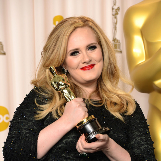 "Singer Adele, winner of the Best Original Song award for ""Skyfall,"" poses in the press room during the Oscars held at Loews Hollywood Hotel on February 24, 2013 in Hollywood, California."