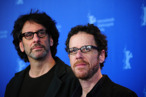 (from L) US film-making brothers Joel Coen and Ethan Coen pose for photographers during a photocall for their movie &quot;True Grit&quot; in Berlin on February 10, 2011 on the first day of the international Berlinale film festival. &quot;True Grit&quot;, an Oscar-nominated remake of the classic western, kicks off the 61st Berlin film festival, a 10-day extravaganza of glitzy entertainment and explosive political fare. The Berlinale takes place from February 10 to 20, 2010.         AFP PHOTO / JOHANNES EISELE (Photo credit should read JOHANNES EISELE/AFP/Getty Images)
