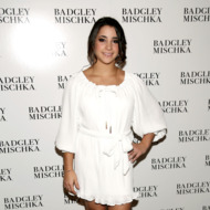 Gymnast Alexandra Raisman poses backstage at the Badgley Mischka Fall 2013 fashion show during Mercedes-Benz Fashion Week at The Theatre at Lincoln Center on February 12, 2013 in New York City.