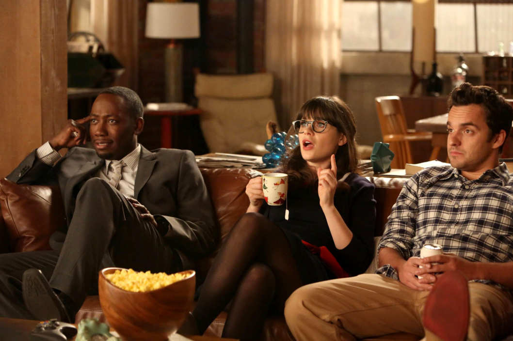 "NEW GIRL:  L-R: Winston (Lamorne Morris), Jess (Zooey Deschanel) and Nick (Jake Johnson) listen as Schmidt tells them of his plans for their big party celebrating Nick and Schmidt's tenth anniversary of living together in the ""TinFinit"" episode of NEW GIRL airing Tuesday, Feb. 26 (9:00-9:30 PM ET/PT)"