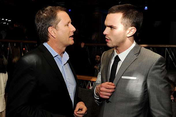 "Michael Burns (L), Vice Chairman, Lionsgate and actor Nicholas Hoult pose at the after party for the premiere of Summit Entertainment's ""Warm Bodies"" at The Colony on January 29, 2013 in Los Angeles, California."