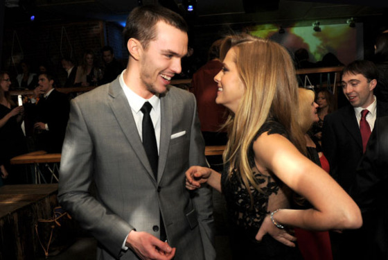 "LOS ANGELES, CA - JANUARY 29:  Actors Nicholas Hoult (L) and Teresa Palmer pose at the after party for the premiere of Summit Entertainment's ""Warm Bodies"" at The Colony on January 29, 2013 in Los Angeles, California.  (Photo by Kevin Winter/Getty Images)"
