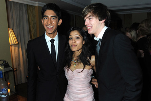 Dev Patel, Freida Pinto and Nick Hoult pose at the Soho House Grey Goose After Party at the Grosvenor House Hotel on February 8, 2009 in London, England.