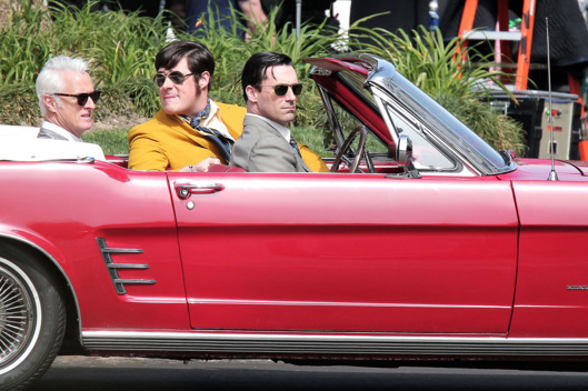 "Jon Hamm, John Slattery and Rich Sommer film a scene for their hit TV show ""Mad Men"" in Los Angeles. The trio can be seen riding around in a red, vintage Mustang Convertible as they filmed scenes for an upcoming episode."