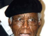 "Nigerian writer, 70, Chinua Achebe is pictured on January 19, 2009 during a welcoming ceremony  at the Transcorp Hilton Hotel in Abuja upon his return to Nigeria for the first time in over 10 years. Achebe, whose most famous work is 1958's ""Things Fall Apart,"" is a literature professor at Bard College in New York state and he is a harsh critic of Nigeria's successive governments, accusing them of corruption and bad governance. He has rejected several national awards and honours."