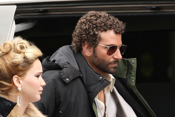 "Exclusive... 51055571 ""Silver Linings Playbook"" costars Jennifer Lawrence and Bradley Cooper are back together again on the set of the new untitled David O. Russell film on April 2, 2013 in Boston, Massachusetts. The pair arrived on set together in full 70's wardrobe. Bradley ""Sexiest Man Alive"" Cooper is looking to one-up Christain Bale's movie comb-over with a nice head of short Jheri curls for his role in this film!"