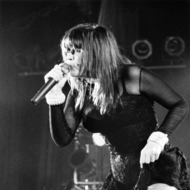 Singer Chrissy Amphlett (1959 - 2013) performing with Australian rock group Divinyls at the Hollywood Palladium, Los Angeles, California, 1991.
