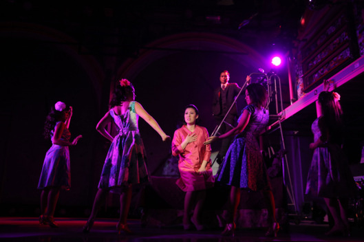 Ruthie Ann Miles (center) and the cast of Here Lies Love, with concept and lyrics by David Byrne, music by David Byrne and Fatboy Slim, additional music by Tom Gandey and J Pardo, choreographed by Anne-B Parson, and directed by Alex Timbers, running at The Public Theater at Astor Place. Photo credit: Joan Marcus