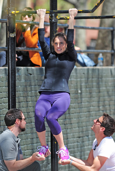 Allison Williams seen being lifted up by the crew, as part of a workout gag on the set of 'Girls' in New York City.