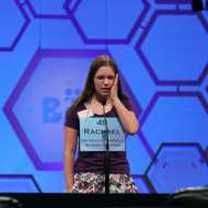 NATIONAL HARBOR, MD - MAY 30:  Rachael Cundey reacts to spelling a word corectly during the third round of the 2012 Scripps National Spelling Bee competition May 30, 2012 in National Harbor, Maryland. 278 spellers are competing in the 85th annual competition.   (Photo by Mark Wilson/Getty Images)