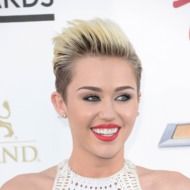 Singer Miley Cyrus arrives at the 2013 Billboard Music Awards at the MGM Grand Garden Arena on May 19, 2013 in Las Vegas, Nevada.