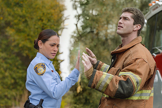 UNDER THE DOME: Deputy Linda (Natalie Martinez, left) and her fiancé, Rusty (Josh Carter), find themselves separated by a massive transparent dome that's suddenly fallen on the town of Chester's Mill, on UDER THE DOME premiering Monday, June 24 (10:00-11:00 PM, ET/PT) on CBS.  UNDER THE DOME is based on Stephen King's bestselling novel.. Photo: Best Possible Screen Grab/©2013 CBS Broadcasting Inc. All Rights Reserved.