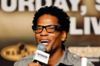 LAS VEGAS - SEPTEMBER 18:  Actor/comedian D.L. Hughley speaks at the official weigh-in for boxers Floyd Mayweather Jr. and Juan Manuel Marquez at the MGM Grand Garden Arena September 18, 2009 in Las Vegas, Nevada. The two will fight at the MGM on September 19.  (Photo by Ethan Miller/Getty Images) *** Local Caption *** D.L. Hughley