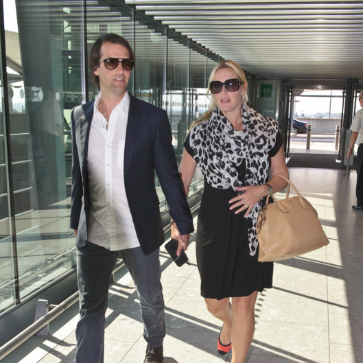 A pregnant Kate Winslet and husband Ned RockNRoll depart Heathrow Airport for Toronto. <P> Pictured: Ned Rocknroll and Kate Winslet <P><B>Ref: SPL605917  050913  </B><BR/> Picture by: Splash News<BR/> </P><P> <B>Splash News and Pictures</B><BR/> Los Angeles:	310-821-2666<BR/> New York:	212-619-2666<BR/> London:	870-934-2666<BR/> photodesk@splashnews.com<BR/> </P>