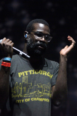 LOS ANGELES, CA - AUGUST 24:  Musician Tunde Adebimpe of the band TV on the Radio performs onstage at the Carrie Stage during Day 1 of FYF Fest 2013 at Los Angeles State Historic Park on August 24, 2013 in Los Angeles, California.  (Photo by Trixie Textor/Getty Images)