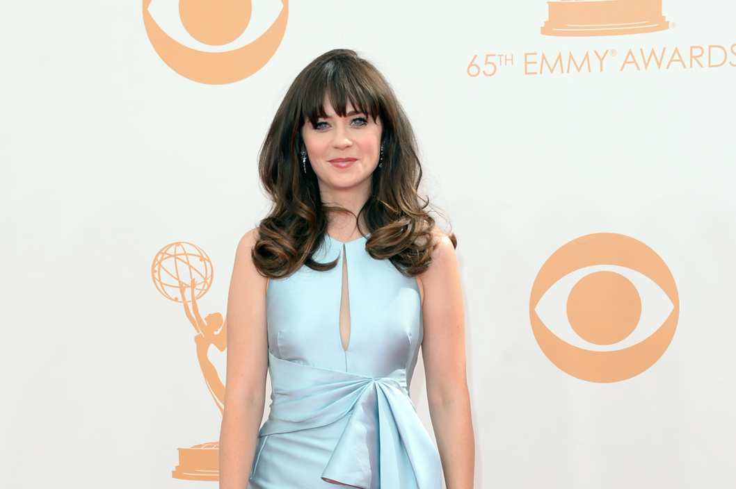 LOS ANGELES, CA - SEPTEMBER 22:  Actress Zooey Deschanel arrives at the 65th Annual Primetime Emmy Awards held at Nokia Theatre L.A. Live on September 22, 2013 in Los Angeles, California.  (Photo by Jason Merritt/Getty Images)