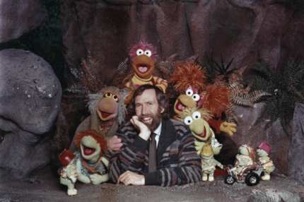 American puppeteer and filmmaker Jim Henson (1936 - 1990) with some of the Muppet cast from the children's TV show 'Fraggle Rock', circa 1985. Along with the diminutive Doozers in the foreground are the Fraggle characters (left to right) Boober, Mokey, Gobo, Red and Wembley. (Photo by Hulton Archive/Getty Images)