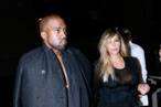 PARIS, FRANCE - SEPTEMBER 29:  Kim Kardashian and Kanye West arriving at Givenchy show as part of the Paris Fashion Week Womenswear  Spring/Summer 2014, held at 'la Halle Freyssinet' on September 29, 2013 in Paris, France.  (Photo by Bertrand Rindoff Petroff/Getty Images)