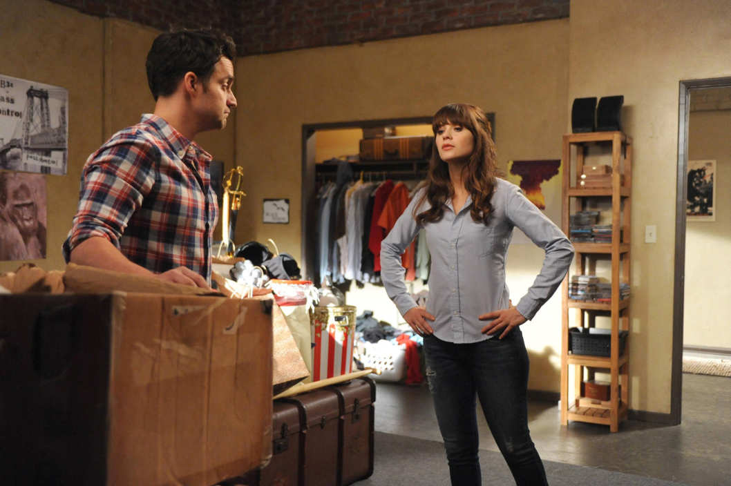 "NEW GIRL:  Nick (Jake Johnson, L) shows Jess (Zooey Deschanel, R) his box of unwanted responsibilities in the ""The Box"" episode of NEW GIRL airing Tuesday, Oct. 15 (9:00-9:30 PM ET/PT) on FOX. ?2013 Fox Broadcasting Co. Cr: Ray Mickshaw/FOX"