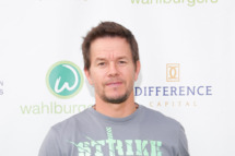 "TORONTO, ON - SEPTEMBER 09:  Mark Wahlberg arrives on the green carpet at the ""Wahlburgers"" premiere at Soho Metropolitan Hotel on September 9, 2013 in Toronto, Canada.  (Photo by George Pimentel/WireImage)"