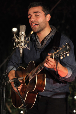 "Actor Oscar Issac performs onstage during reception honoring Joel and Ethan Coen and T Bone Burnett to celebrate the music of ""Inside Llewyn Davis"" at Buffalo Club on November 13, 2013 in Santa Monica, California."