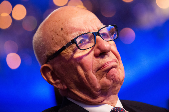 Rupert Murdoch listens to U.S. President Barack Obama make remarks at the Wall Street Journal CEO Council annual meeting, at the Four Seasons Hotel, on November 19, 2013, in Washington, DC. Obama discussed immigration reform and the health care rollout, among other topics.