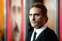 "LOS ANGELES, CA - DECEMBER 12:  Actor Joaquin Phoenix attends the premiere of Warner Bros. Pictures ""Her"" at DGA Theater on December 12, 2013 in Los Angeles, California.  (Photo by Frazer Harrison/Getty Images)"