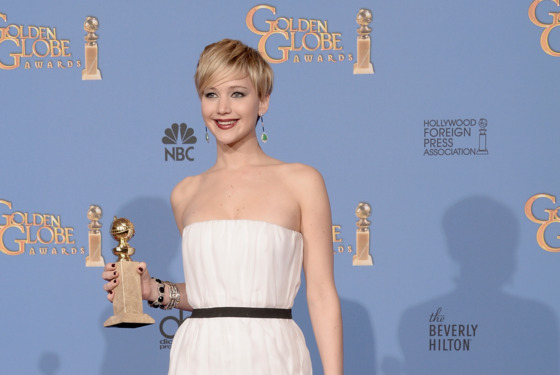 BEVERLY HILLS, CA - JANUARY 12:  Actress Jennifer Lawrence, winner of Best Supporting Performance in a Motion Picture – Drama, Musical or Comedy for 'American Hustle,' poses in the press room during the 71st Annual Golden Globe Awards held at The Beverly Hilton Hotel on January 12, 2014 in Beverly Hills, California.  (Photo by Kevin Winter/Getty Images)