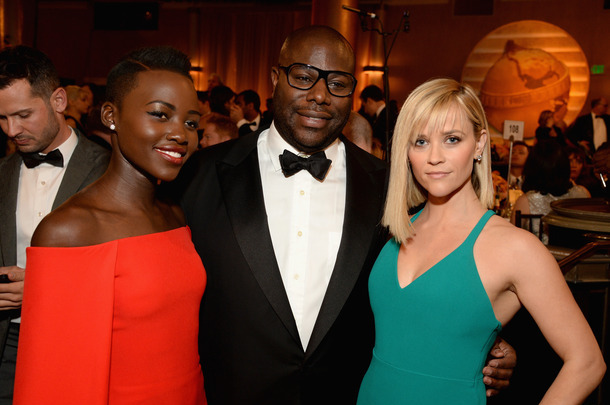 LOS ANGELES, CA - JANUARY 12:  (L-R) Actress  Lupita Nyong'o, director Steve McQueen and actress Reese Witherspoon with Moet & Chandon At The 71st Annual Golden Globe Awards at the Beverly Hilton Hotel on January 12, 2014 in Los Angeles, California.  (Photo by Michael Kovac/Getty Images for Moet & Chandon)