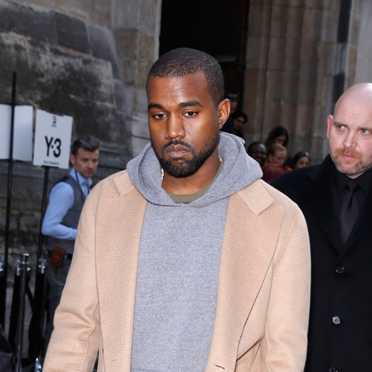 PARIS, FRANCE - JANUARY 19:  Kanye West attends the Y-3 Menswear Fall/Winter 2014-2015 Show as part of Paris Fashion Week on January 19, 2014 in Paris, France.  (Photo by Richard Bord/Getty Images)