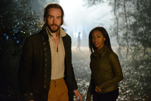 "SLEEPY HOLLOW: Ichabod Crane (Tom Mison, L) and Lt. Abbie Mills (Nicole Beharie, R) search for clues in the ""Bad Blood,"" part 2 of the special two-hour Season Finale episode of SLEEPY HOLLOW airing Monday, Jan. 20 (8:00-10:00 PM ET/PT) on FOX."