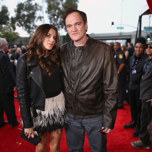 LOS ANGELES, CA - JANUARY 26:  Director Quentin Tarantino (R) and guest attend the 56th GRAMMY Awards at Staples Center on January 26, 2014 in Los Angeles, California.  (Photo by Christopher Polk/Getty Images for NARAS)