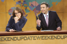 "SATURDAY NIGHT LIVE -- Episode 4 -- Aired 11/02/2002 -- Pictured: (l-r) Tina Fey, Jimmy Fallon during ""Weekend Update"" -- Photo by: Mary Ellen Matthews/NBCU Photo Bank"