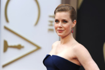 "Nominee for Best Actress in ""American Hustle"" Amy Adams arrives on the red carpet for the 86th Academy Awards on March 2nd, 2014 in Hollywood, California. AFP PHOTO / Robyn BECK        (Photo credit should read ROBYN BECK/AFP/Getty Images)"